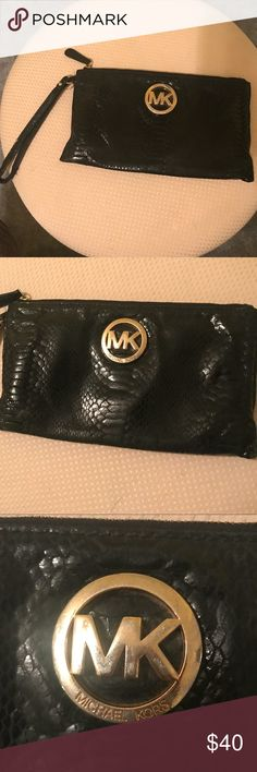Michael Kors wristlet Real Michael Kors wristlet . Has some wear on it as shown in pictures. Black and gold. Plenty of room inside. A great piece to complete any outfit! Michael Kors Bags Clutches & Wristlets