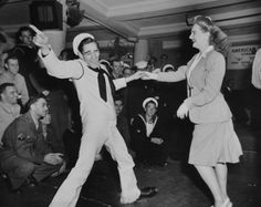 """The guy in the Navy uniform is """"Killer Joe"""" Piro who went on to become a famous and constantly relevant dance instructor on the East Coast.  He was the model for the part played by John Travolta in Saturday Night Fever. June 1942....."""