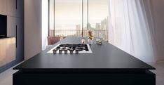 Caesarstone, the company that invented quartz surfacing for kitchens and other home interiors, has a new quartet of dramatic kitchen counter colors. Downtown Lofts, Downtown Restaurants, Granite, Monochrome, Polished Concrete, Commercial Interiors, Concrete Floors, Kitchen Countertops, Home Collections