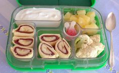Nutella-banana sushi - easy to make and a sure hit with your kids. This Yumbox also includes vanilla yogurt, raw cauliflower, pineapple chunks, and 2 candies for a treat.