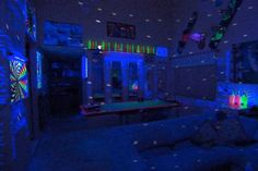 "It looks fairly normal to the naked eye, but switch off the lights at this Cal Poly San Luis Obispo party spot, and you've got the ultimate black-light room. The three guys who live in this apartment tricked it out with 10 black lights to light up their many posters, disco ball and anything else that will glow. They even ""write"" on the walls with transparent tape that is invisible by day but glows brightly in the dark."