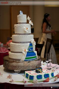 Best. Wedding. Cake. Ever. Little peek of the bride and groom's favorite sports teams. Awesome!