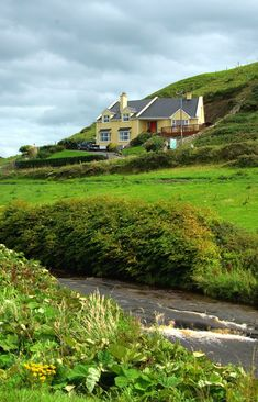 Ireland~On our way from Doolin to Lahinch, this was a photo of a house on the coast. Photographer: C. McCloskey