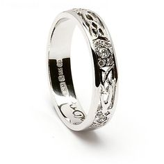 For this very special Celtic wedding ring, our craftsmen have set the design of the Trinity knot into the band of the ring and separated each pattern with a cluster of sparkling diamonds, the center one being .12ct. The Trinity can represent the father, the Son and the Holy Ghost. Choose from the rich color of yellow gold or the cool look of white gold, as always, your ring will show the hallmark of the Dublin Assay Office, this is your assurance of quality. According to legend, Eimear…