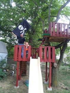 Pallet tree house; we need to build something like this for the kids, minus the pirate them. And maybe add a roof? They would love it! :)