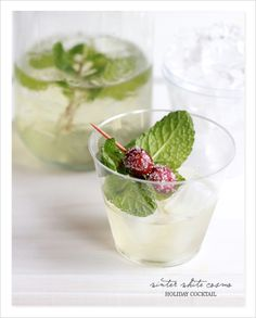white winter cosmo Winter White Cosmo citron vodka with white cranberry juice, cointreau, and a hint of fresh lime. Garnish with mint and sugered cranberries.
