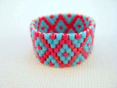 Beadwork Peyote Ring in Turquoise and Red  Beaded Seed Bead Delica - size 8. $14.00, via Etsy.