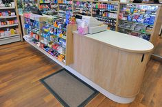 Pharmacy dispensary design and over the counter shelving and storage solutions. Pharmacy Design, Retail Design, Cashier Counter Design, Pharmacy Store, Shop Counter, Store Layout, 7 Eleven, Showroom Design, Shelf Design