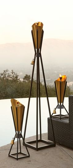 Our Hilligard Torchu0027s Symmetrical Design Elevates Functional Lighting To  Captivating Artwork.