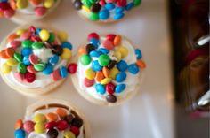 Rainbow M & Ms on vanilla ice cream cones - super easy can all so do iced sugar cookies.