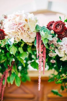 #ThingsWeLove: elaborate ceremony arches! Combining rich greens, soft pinks, white and deep plum this #flowerceremonyarch detail is definitely something to wow about.  #detail #ceremonyarch @fabiozardi #weddingdetails #weddinginCrete
