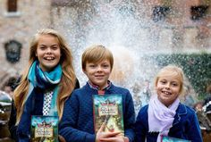 Princess Laurentien and Prince Constantijn's three children with their mother's book. From left: Countess Eloise, Count Claus-Casimir and Countess Leonore.