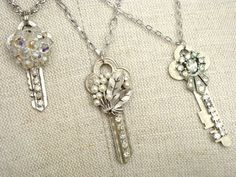 DIY Key Necklaces = all you need is keys, bling and E6000 glue!!!  Have fun! (fun idea for keys with a memory attached).