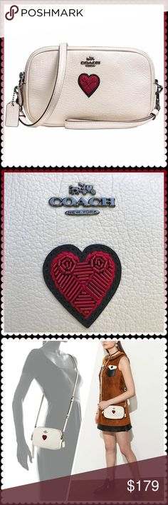 """Coach crossbody clutch with heart embroidery NWT. ♥️ Coach grain leather crossbody clutch with souvenir embroidery. Gunmetal grey hardware. Straps removable to wear as clutch or crossbody. Fits all smart phone models. Approx 6.5"""" wide, 5"""" height, 1.75"""" depth. 2 zippered compartments (one side with interior open pocket; other side with 2 credit card slots). Crossbody Strap has 5 adjustment holes. Coach Bags Crossbody Bags"""