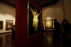 MEXICO CITY.- People look at paintings by Colombian artist Fernando Botero during the inauguration of his retrospective exhibit titled Fernando Botero: a celebration at the Fine Arts Palace in Mexico City.