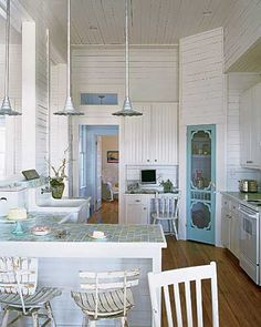 The blue pantry door (a former screen door) makes the kitchen - all of the fun elements flow from that door.