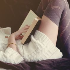 This looks like me on a lazy Sunday--sweater, leggings, and a good book.