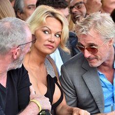 Liam Cunningham, Pamela Anderson and Eddie Irvine share a secret at Monaco auction (337309)