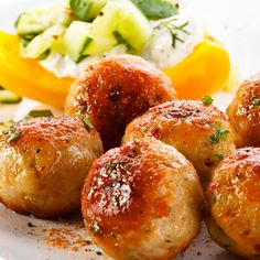 These very tasty baked chicken balls have pine nuts and a nice assortment of seasonings.. Baked Chicken Balls Recipe from Grandmothers Kitchen.