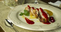 Chicken Rolls with Smoked Bacon, Carrot Puree and Red Berry Sauce by greek chef Akis. A unique but simple dish that will impress!