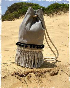 'Breeze' summer sac ~ bag Dimensions : height 50 cm , diameter 22cm #breeze #summer #sea #summeringreece #greekislands #summerstyle #beach #salt #summerbags #beachstyle #sun #sand #bagaccessories #bathingsuit #blue #ropes #pompon #fringes #grey #bag #flatpouch #photoshooting  #desing #newcollection2016 #sunset