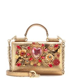 Dolce & Gabbana - Embellished metallic leather shoulder bag - Dolce & Gabbana gets in on the mini bag trend of the season with this shoulder bag. Combining the brand's 'Scared Heart' motif with iconic red and gold-tone embellishment, this leather beauty will add an opulent final note to evening attire. seen @ www.mytheresa.com