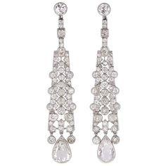 Art Deco Cartier  Diamond Platinum Drop Earrings | From a unique collection of vintage dangle earrings at https://www.1stdibs.com/jewelry/earrings/dangle-earrings/