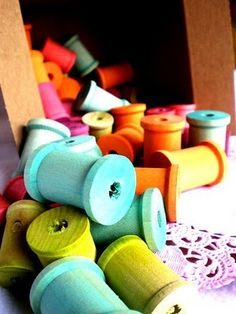 Cute decor for craft room - jar/clear vase full of brightly painted spools!