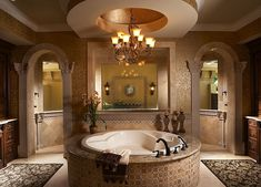 Mediterranean Master Bathroom with stone tile floors, Wall sconce, Standard height, Crown molding, Wrought iron chandelier
