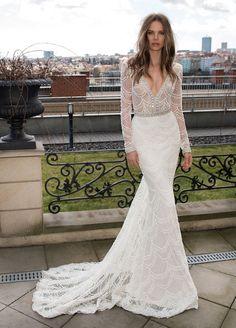 Showstopper alert! Flaunt your figure in this plunging neckline dress by Berta. #weddingdresses #bridalfashion