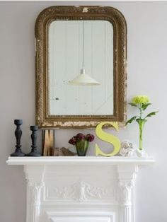 mantle - i like the idea of getting a d, l and c wooden letter and painting it a pretty color to lean on the mantle in a group.