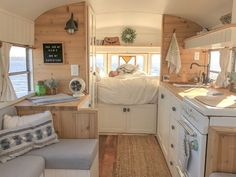A couple and their baby call this converted school bus home when they are on the road having adventures. A couple and their baby call this converted school bus home when they are on the road having adventures. Bus Living, Tiny House Living, Living In A Caravan, School Bus Conversion, Conversion Van, Sprinter Van Conversion, Casas Trailer, School Bus Tiny House, School Bus Rv