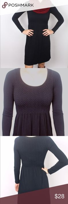 Long sleeve, scoop neck black dress Scoop necked, long sleeve, black dress. Features a form fitting top & sleeves, with a straight fit skirt. This dress is perfect for pairing with jackets, tights, & heavier scarves. A great fall basic for layering! Dresses Long Sleeve