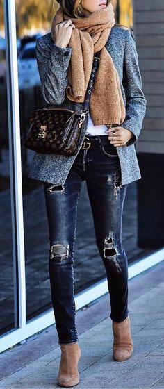 chic sporty style wearing rips with a coat