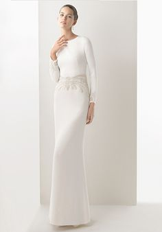 This sleek, column wedding dress was worn by designer Rosa Clará herself on her wedding day. This stunning Art Deco inspired dress has long sleeves, a button-loop back, and symmetrical beadwork on the waist and sleeve hems.