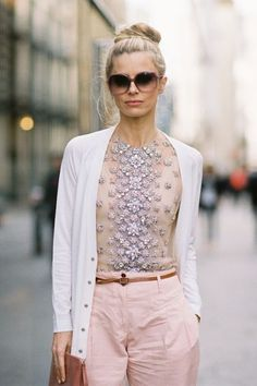 Dressed down an embellished top with a cardigan, tan belt and colored pants.