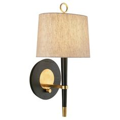 Ebony Finished Wood with Antique Brass Finished Accents and Natural Linen Shade with Rolled Edge Hem.