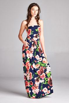 Wear-anywhere strapless maxi dress with pockets in soft, drapey modal featuring a beautiful large floral print. Top is lined and features ruching. Fabric is str