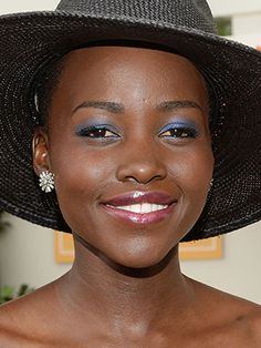 Look We Love: Lupita Nyong'o's Bright  Makeup: Re-pin your favorite jewel tone looks. We're pinning with #RenttheRunway.