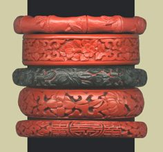 I have a particular weakness for a clanking wrist full of these cinnabar bracelets.