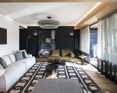 Located in Lyon, France, this bold and contemporary house design was created by Claude Cartier Studio. Dark colors, a selection of luxury furniture, lush prints Dark Living Rooms, Living Room Modern, Living Room Designs, Living Room Decor Inspiration, Living Room Remodel, Contemporary Interior Design, Contemporary Houses, Apartment Design, Small Spaces