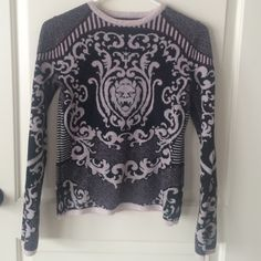 Rachel Roy Baroque Lion Merino Wool Sweatet Lovely and warm sweater. Soft wool. Says medium. Fits like small. Longer sleeves. Black and white with a hint or burgundy throughout the sweater. The back and front look the exact same.  Looks FABULOUS on its own with a pair of jeans and booties. Rachel Roy Sweaters Crew & Scoop Necks