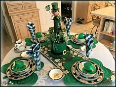Set a charming St. Patrick's Day table with Ireland Pursuit hunt and game dishes, etched crystal pilsner glasses, Irish linens, shamrock-shaped ornaments dangling from overhead, and Lucky the Leprechaun DIY centerpiece.