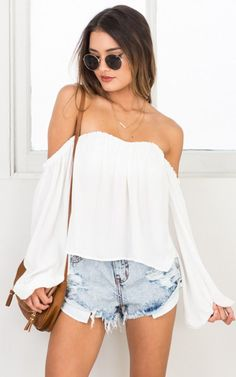 This off the shoulder top is a must have for any season! Its billowy sleeves make the perfect silhouette when paired with denim cutoffs
