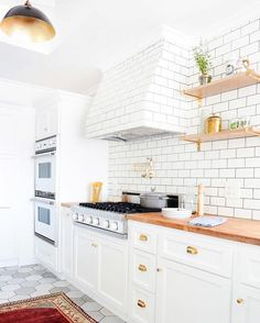 Start the New Year off with a . What's one way you can style your own flashy home this year? Mix graphic elements in unexpected ways—like this kitchen does with the two different tiles. For more décor inspiration for your New Year, tap the link in our bio. | photo: @tessaneustadt for @homepolish; design: @stefanisteinla