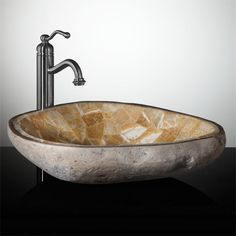River stone vessel sink with mosaic interior.
