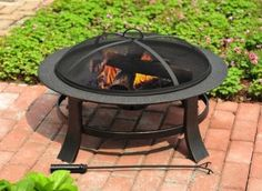 """30"""" Matte Blace Steel Wood-Burning Firebowl from Lowe's.  Clean simple, and accessible.  Only $39.00 too!"""