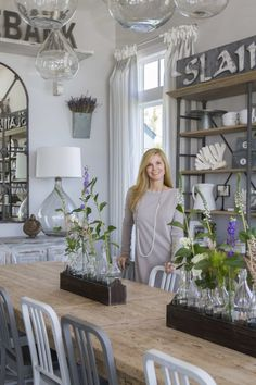 """""""This room was designed around Orla's antique table that we had stripped down to the natural wood,"""" says Carol. An open shelf buffet filled with Orla's collection of white dishes sits behind the table. Multiple sizes of hanging glass pendants from Bobo Intriguing Objects (bobointriguingobjects.com) line the table."""