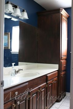 Stain Bathroom Cabinets Darker dark walnut stained oak cabinets. this could be a good color