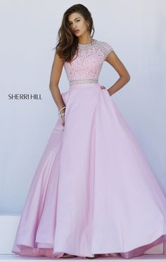 Charm him with the dreamily delightful Sherri Hill 32363 full-length prom dress. This radiant gown creates a romantic A-line silhouette. The lovely lace bodice is accented with beads and beaded latticework. It features a beaded scoop neckline framed with cap sleeves and a scalloped edged diamond cutout back. A sleek beaded band accentuates the waistline above the cascading layers of the full skirt with sweep train.